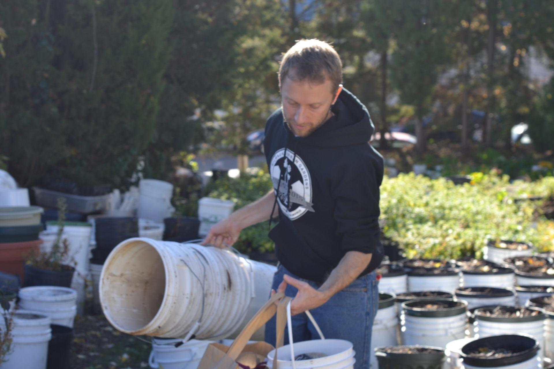 "Nick DeMarsh at his small urban farm, ""Farm a Sea of Green."""