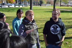 DeMarsh and Nora Justin, a 6th grade teacher at Alexander Mitchell Integrated Arts School, lead a field trip of the graden plots at Kilbourn Park in Milwaukee.
