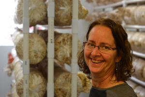 Carolyn Mello, in front of one of the mushroom grow rooms.